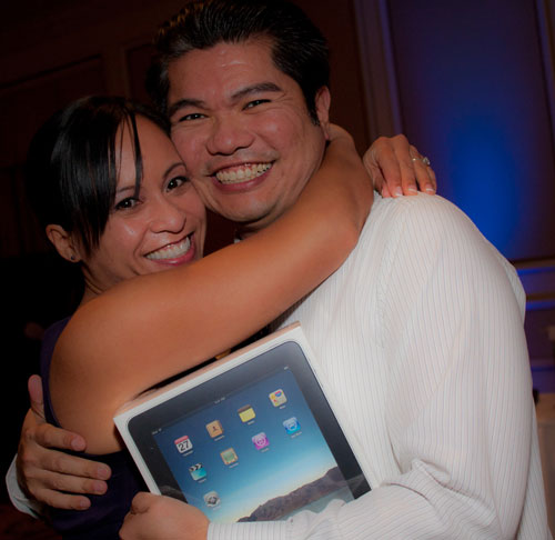 You'd be smiling too if you won an iPad in the employee raffle!