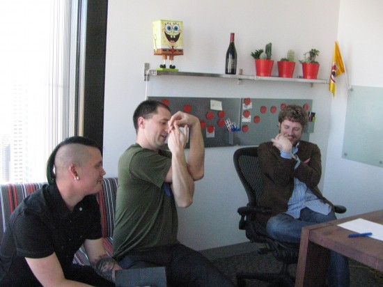 "Josh teaches Matt ""the confused programmer"" pose"