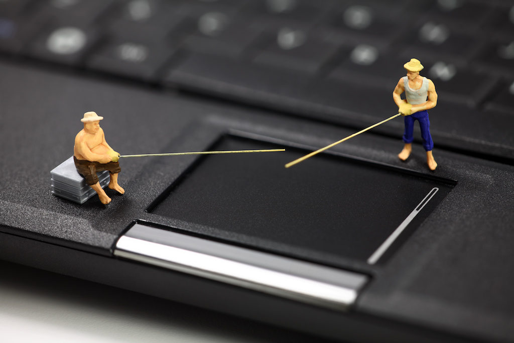 Miniature fisherman representing online email phishing scams.
