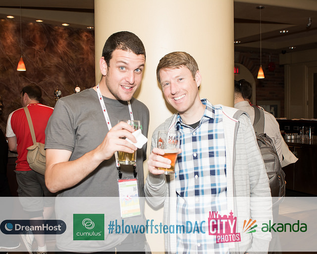 Justin Lund (Right) with an attendee at the Blow Off Steam party at OpenStack Summit Vancouver