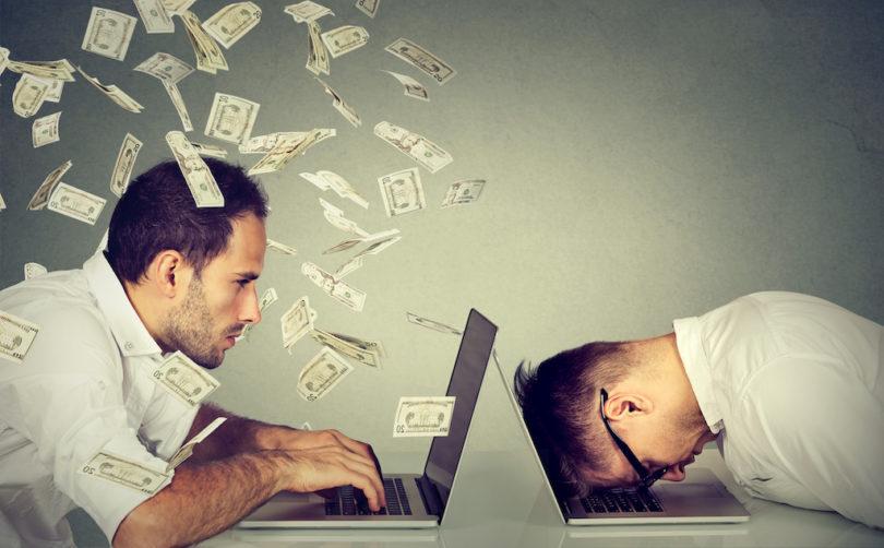 Stressed desperate burnout man resting sleeping on laptop sitting next to professional man under money dollar rain