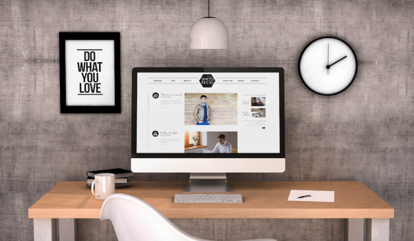 digital generated workspace desktop with male fashion blog on screen computer.