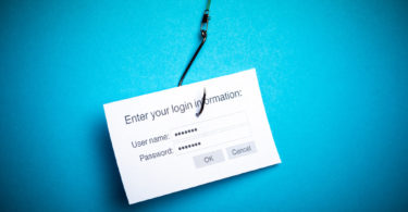 Concept of hacking or phishing a login and password with malware program