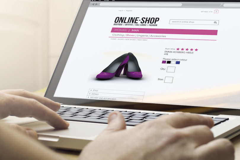 home online shopping concept: man using a laptop to go shopping
