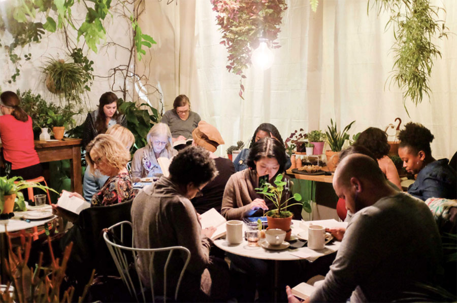 Readers gather for Silent Book Club events around the world.